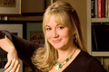 Megyn Price as Audrey