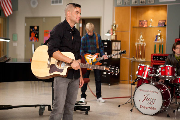 Puck with his guitar