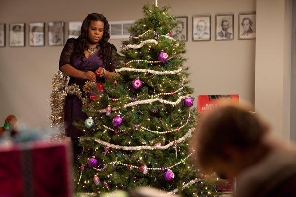 Mercedes decorating the choir room Christmas tree