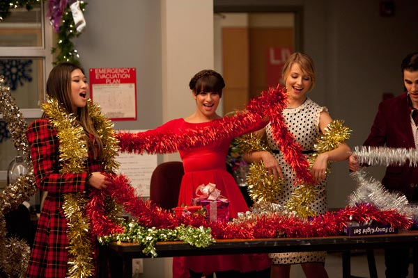 Tina, Rachel and Quinn get into the holiday spirit playing with tinsels